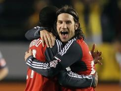 Toronto FC's Aaron Maund, left, and Torsten Frings celebrate their CONCACAF Champions League quarterfinal victory over the L.A. Galaxy.