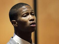 Minnesota Vikings NFL cornerback Chris Cook appears in court in Minneapolis on March 7, 2012.