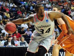 Bearcats forward Yancy Gates finished Friday's game with 15 points and 10 rebounds, both team highs.