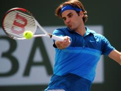Roger Federer strikes a forehand during his quarter final match against Juan Martin Del Potro at the BNP Paribas Open. Federer won 6-3, 6-2 to move into the semifinals.