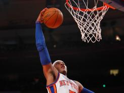 New York small forward Carmelo Anthony (7) drives to the basket. Jeremy Lin scored 13 poitns and the Knicks beat the Pacers 115-100.