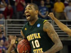 Kyle O'Quinn celebrates Norfolk State's upset over Missouri in the NCAA tournament second round.
