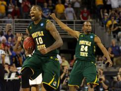 Kyle O'Quinn (10) and Brandon Wheeless (24) celebrate Norfolk State's upset of Missouri