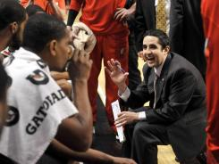 Portland head coach Kaleb Canales talks to his team during a timeout against Chicago, Friday, March 16, 2012, in Chicago. The Trail Blazers beat the Bulls, 100-89.
