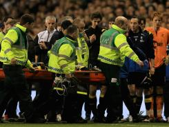Bolton's Fabrice Muamba is taken off the field on a stretcher, still unconscious after receiving CPR treatment on the pitch after suddenly collapsing during the Wanderers' match against Tottenham Hotspur on Saturday in London, England. The game was not resumed.