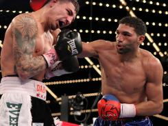 Edwin Rodriguez, right, defeated Donovan George in their super middleweight bout Saturday night at Madison Square Garden.