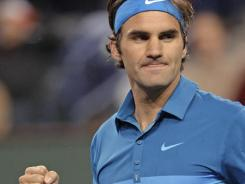 Roger Federer celebrates after defeating Rafael Nadal, 6-3, 6-4 in a semifinal at the BNP Paribas Open in Indian Wells, Calif. Federer will face American John Isner in the finals.