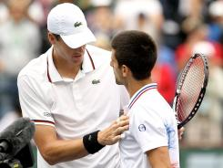 John Isner of the USA meets Novak Djokovic of Serbia after Isner defeated the world No. 1 in the semifinals of the BNP Paribas Open at the Indian Wells, Calif., on Saturday.