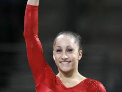 Jordyn Wieber waves to the crowd after winning the gold medal in the senior women's all-around competition at the 2012 Pacific Rim Championships at Comcast Arena in Everett, Wash.