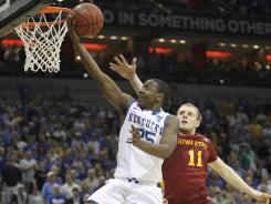 Marquis Teague (25) drives to the bucket for two of his game-high 24 points in Kentucky's third-round win.