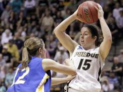 Purdue guard Courtney Moses, right, surveying the floor as South Dakota State guard Tara Heiser defends, drilled an NCAA tournament-record nine 3-pointers in the Boilermakers' 83-68 win.