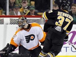 Boston Bruins center Patrice Bergeron scores on Philadelphia's Ilya Bryzgalov in the shootout.