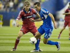 Montreal's Davy Arnaud scored the first goal in Impact history in the team's 1-1 tie with the Chicago Fire on Saturday at Montreal.