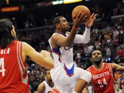Los Angeles guard Chris Paul (3) had 23 points and the go-ahead basket to give the Clippers a 95-91 victory over the Houston Rockets on Saturday night at the Staples Center.