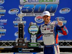 Elliott Sadler celebrates his win in the victory lane at Saturday's NASCAR Nationwide Series 300 auto race in Bristol, Tenn., Saturday, March 17, 2012. Although Salder went 14 years without winning a title, he has won two in the last three weeks.