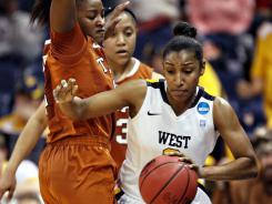 West Virginia's Taylor Palmer has been a steady scoring presence off the bench this season, averaging 10.9 points entering Saturday's tournament game.