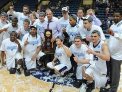 Wisconsin-Whitewater celebrates its third Division III men's basketball title.