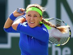 Victoria Azarenka of Belarus smacks a backhand during her victory Sunday against Maria Sharapova of Russia in the final of the BNP Paribas Open.