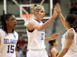 Delaware's Elena Delle Donne (11) celebrates with teammates Akeema Richards (15) and Trumae Lucas (21) during their win against Arkansas-Little Rock on Sunday.
