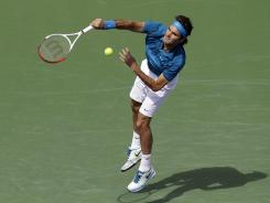 Roger Federer of Switzerland serves up a victory Sunday against John Isner of the USA in the final of the BNP Paribas Open. It was Federer's fourth Indian Wells title.