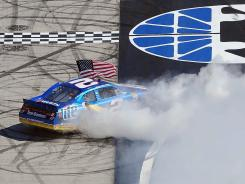 Brad Keselowski burns out his No. 2 Dodge while celebrating after his second consecutive win at Bristol Motor Speedway.