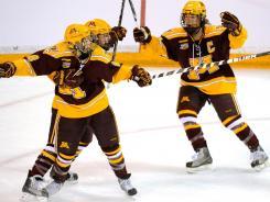 From left, Amanda Kessel, Rachael Bona and Jen Schoullis celebrate Kessel's first-period goal for Minnesota.