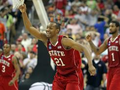Wolfpack guard/forward C.J. Williams (21) celebrates after beating the Georgetown Hoyas.