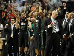 Head coach John Groce of the Ohio Bobcats celebrates after defeating South Florida Sunday night.