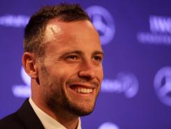 Oscar Pistorius speaks at a news conference after receiving the Laureus World Sportsperson of the Year with a Disability trophy on Feb. 6 in London.