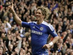 Chelsea's Fernando Torres celebrates the second of his two goals during an English FA Cup quarterfinal soccer match against Leicester City Sunday in London.