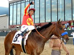 Jockey Rafael Bejarano celebrates aboard Secret Circle after winning the $500,000 Rebel Stakes horse race at Oaklawn Park in Hot Springs, Ark., on March 17, 2012.