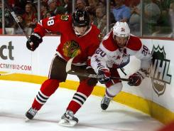 Chicago Blackhawks' Patrick Kane checks Washington Capitals' Troy Brouwer during their game in Chicago on Sunday.