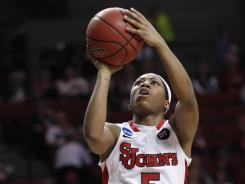 Guard Nadirah McKenith drove the length of the floor, scoring on a layup with 0.1 second remaining, to lead St. John's to a 69-67 win over Creighton.