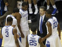 Kentucky head coach John Calipari talks with his players in the second half of Saturday's game.