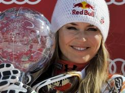 Lindsey Vonn poses with her overall World Cup crystal globe during the podium ceremony of the FIS Alpine Skiing World Cup in Schladming, Austria on Sunday.