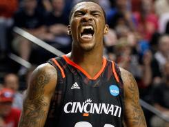 Sean Kilpatrick, who had a game-high 18 points, celebrates Cincinnati's first trip to the regional semifinals since 2001.