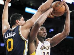 Jazz forward Enes Kanter had 17 points and eight rebounds in Utah's 103-99 win over the Lakers on Sunday at Los Angeles.