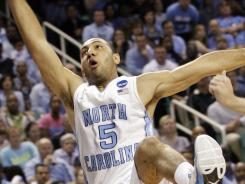 North Carolina's Kendall Marshall falls, fracutring his wrist during the second half of the Tar Heel's third-round NCAA tournament game against Creighton in Greensboro, N.C.