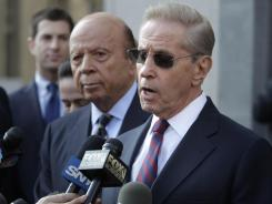 New York Mets owners Fred Wilpon, right, and Saul Katz reached a $162 million lawsuit settlement with the trustee for Bernard Madoff's fraud victims.
