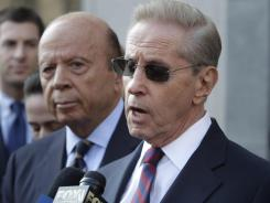 Mets' owners Fred Wilpon, right, and Saul Katz talk to the media in front of federal court in New York on Monday.