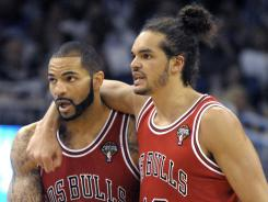 Chicago's Carlos Boozer, left, had 24 points and 13 rebounds in the Bulls' 85-59 win over the Magic on Monday night at Orlando.