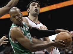 Boston's Ray Allen drilled two late three-pointers and finished with 19 points in the Celtics' 79-76 win over the Hawks on Monday night at Atlanta.