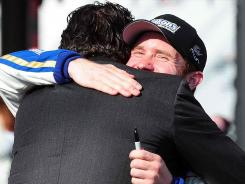 Brian Vickers hugs team owner Michael Waltrip after the Food City 500. Vickers placed fifth in the first of a six-race gig for MWR.