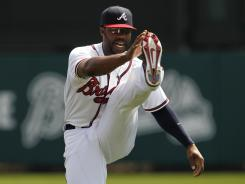 Jason Heyward, stretching Monday before a spring training game, slumped as a sophomore. The Braves hope a return to health will solve the issues.