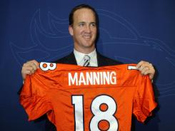 New Denver Broncos quarterback Peyton Manning says he's joined the team to win now, not later.