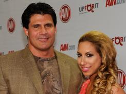 Former Major League Baseball player Jose Canseco, here with model Leila Shennib in January, believes he can hit 30 to 40 home runs for a big-league club.