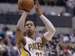 Indiana Pacers forward Danny Granger shoots over Los Angeles Clippers forward Caron Butler in the second half on Tuesday. The Pacers defeated the Clippers 102-89.