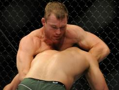 Matt Hughes, facing camera, hasn't won since choking out Ricardo Almeida an an August 2010 fight in Oakland, Calif.