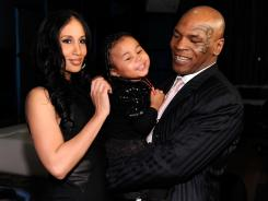 Kiki Tyson (left) and Mike Tyson are trying to make a new life together. The Tysons live with 3-year-old daughter, Milan (center) and 14-month-old son, Morocco (not pictured) in an exclusive gated community outside Las Vegas.