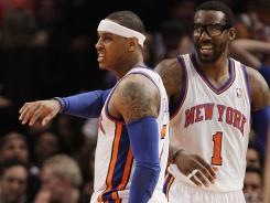 Carmelo Anthony, left, and Amar'e Stoudemire were two of five Knicks in double figures in the win over the Raptors.